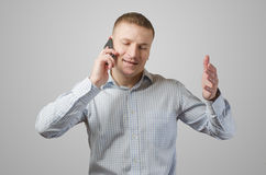 Young businessman talking on a cell phone. Royalty Free Stock Images
