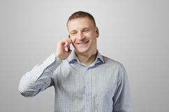 Young businessman talking on a cell phone. Royalty Free Stock Photos