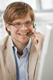 Young businessman talking on headset Stock Photography