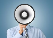 Young businessman talking on the megaphone on. Business one man talking businessman megaphone obscure face Stock Photos