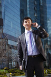 Young businessman talking on mobile phone. Stock Photography