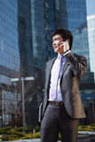 Young businessman talking on mobile phone. Stock Photo