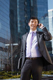 Young businessman talking on mobile phone. Stock Photos