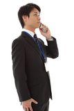 Young businessman is talking on a mobile phone Stock Images