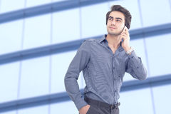 Young businessman talking mobile phone Stock Photo