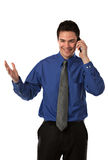 Young Businessman Talking over Cell Phone Stock Image