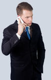YOUNG BUSINESSMAN TALKING OVER CELL PHONE Stock Images
