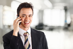 Young businessman talking at phone Royalty Free Stock Photos