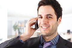 Young businessman talking at phone Royalty Free Stock Image
