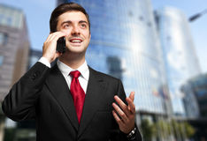 Young businessman talking on the phone Royalty Free Stock Photo
