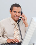 Young businessman talking on phone in the office Royalty Free Stock Photo