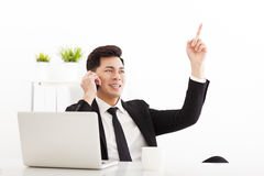 Young businessman talking on the phone in  office Royalty Free Stock Images