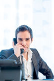 Young Businessman Talking on Phone at the Office Stock Image