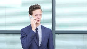 Young Businessman Talking on Phone, Outdoor stock footage
