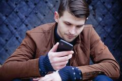 Young hipster businessman talking phone outdoors. Young businessman talking phone outdoors Royalty Free Stock Photos
