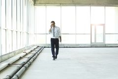 Young businessman talking on the phone royalty free stock photography