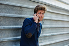 Young businessman talking smartphone phone Stock Photos