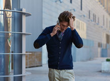 Young businessman talking smartphone walking Stock Photography