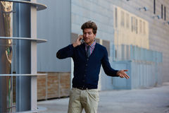 Young businessman talking smartphone walking Royalty Free Stock Image
