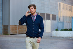 Young businessman talking smartphone walking Royalty Free Stock Images