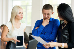 Young businessman talking to his partners. Stock Photos