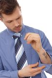 Young businessman with tattoo in forearm Royalty Free Stock Image