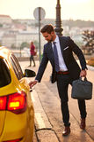 Young businessman with a taxi Stock Photos