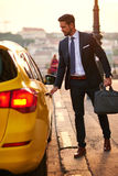 Young businessman with a taxi Royalty Free Stock Images