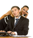 Young businessman with telephone. Wire around his neck on a computer and a young business woman with a telephone receiver on white background Royalty Free Stock Photos