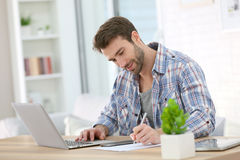 Young businessman teleworking Stock Image