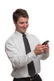 Young Businessman Texting on Cell Phone Stock Photo