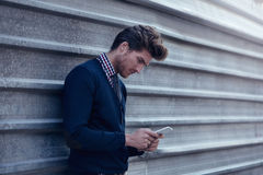 Young businessman texting smartphone phone Royalty Free Stock Images