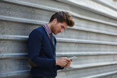 Young businessman texting smartphone phone Royalty Free Stock Photography