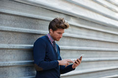 Young businessman texting smartphone phone Stock Photography