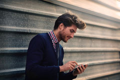 Young businessman texting smartphone phone Stock Image