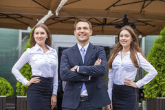 A young businessman with their secretaries Stock Photography