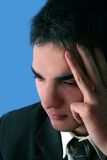 Young Businessman thinking. Isolated on blue Royalty Free Stock Photos