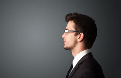 Young businessman thinking with copyspace Royalty Free Stock Photography