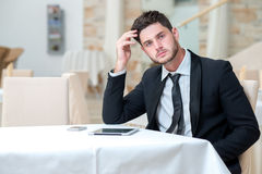 Young businessman is thinking about further business projects Stock Photos