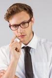 Young businessman thinking looking at camera Royalty Free Stock Image