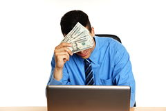 Young businessman thinking with money stock photography