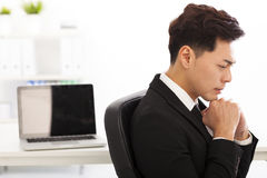 Young businessman thinking in the  offic Stock Photos
