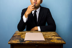 Young businessman thinking Royalty Free Stock Photos