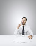 Young businessman thinking Stock Images