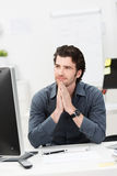 Young businessman thinking of a solution Stock Photography
