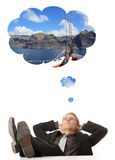 Young businessman thinking about vacations Royalty Free Stock Photos