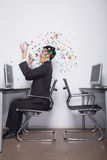 Young Businessman throwing confetti in the office Royalty Free Stock Photography