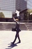Young businessman throwing paper Royalty Free Stock Photography