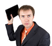 The young businessman throws out laptop Stock Photo