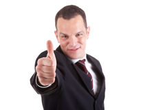 Young businessman with thumb raised as a sign of s Royalty Free Stock Photos